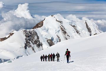 Mountaneers walking on a glacier, Monte Rosa, Switzerland