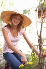 Teenage Girl Relaxing In Garden