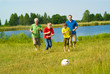 happy family playing soccer