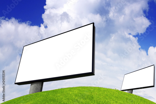 Advertising billboard on green field