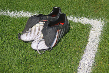 Pair of football boots on the grass