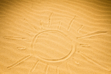 Big sun shape written on rippled sand