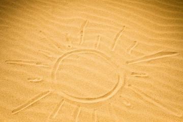 Big sun shape written on rippled sand
