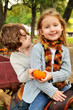 Little Girl and Boy on Wagon with Pumpkin in the Fall