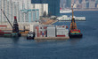 Barges being loaded at a container terminal in Hong Kong