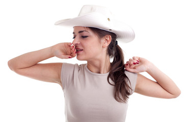 yawning stretching female tourist in white hat