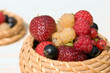 Strawberry, raspberry, and  currant in a bast basket