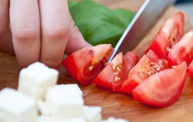 Cutting fresh tomatoes