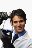 lab technician holding a flask with a fluid inside poster