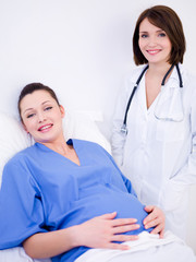Pregnant woman and doctor at hospital