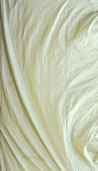 White tarpaulin with swirls and corner creases