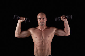 Sexy male with dumbells