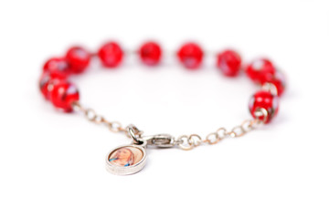 Red bracelet with medalion containing the picture of Mary Magdal
