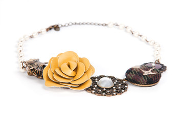 Necklace with leather, fabric and metal details isolated on whit