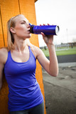Sporty woman drinking