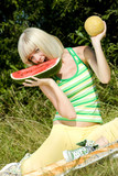 woman with melons at a picnic