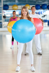 people with pilates ball
