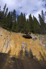 Cave on red cliff of Johnson Canyon, Banff, Alberta