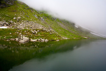 Balea Lake in Romania under a blanket of clouds
