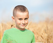 Adorable child in a wheat field