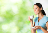 Fototapety Young happy smiling woman drinking coffee, outdoors