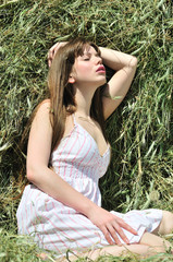sensual girl in dry grass