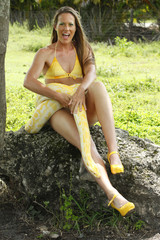 Young woman with an albino burmese python