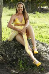 Young woman with an albino burmese python