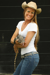Animal handler with Asian water monitor lizard