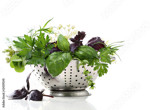 Wet herbs in colander