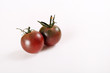 tiny heirloom deep purple cherry tomatoes