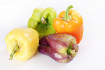 assorted colorful peppers on white