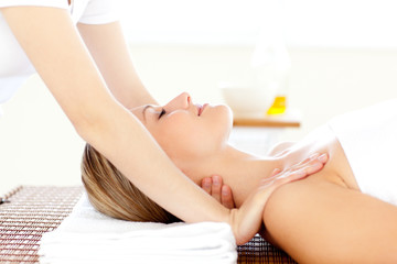 Portrait of a caucasian young woman having a massage