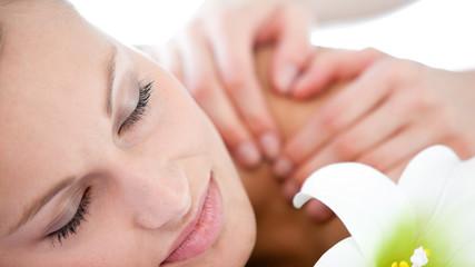 Portrait of a caucasian woman having a massage
