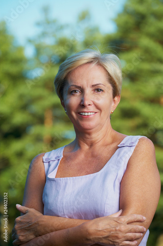 Cheerful mature woman looking at camera