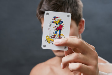 Joker in a hand with man