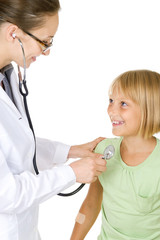 Doctor examining little child girl
