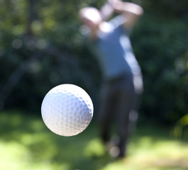 A golf ball in flight