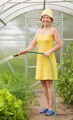 woman watering vegetables