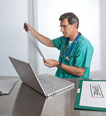 Doctor Reading Diagnostic Film Scans