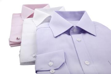 folded male shirts isolated on white