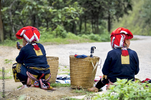 Hill tribe women waiting by the roadside