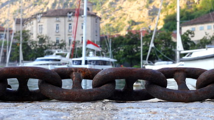 Yachts and boats bound chains