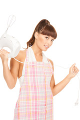 housewife with mixer