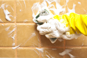 hand in yellow rubber glove