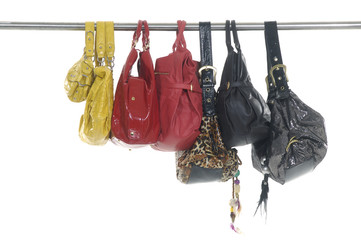 Colorful different fashion handbags hanging
