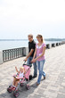 family walking on embankment