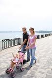 family walking on embankment poster