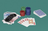 Poker gaming table with cards, bets and red quint flush poster