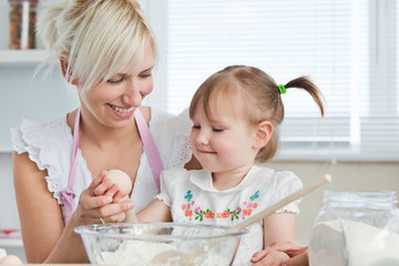 Smiling Mother and child baking cookies